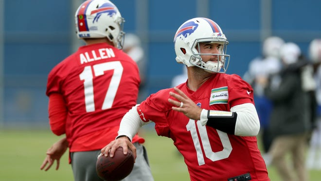Bills quarterbacks AJ McCarron and Josh Allen during drills at mini-camp.