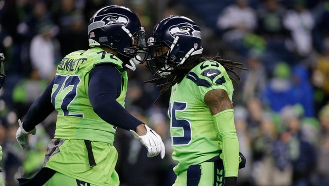 Former Seahawks Michael Bennett, left, and Richard Sherman have said coach Pete Carroll's message got stale over the years. Bennett went so far as to suggest that he read books while Carroll addressed the team.