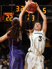 Vanderbilt freshman Rachel Bell (3) tries to shoot over James Madison's Hailee Barron on Monday night at Memorial Gym.