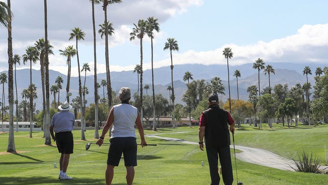 Golfers tee off on the first hole at Shadow Mountain Golf Club in Palm Desert.