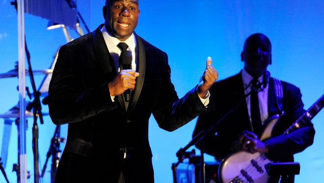 "FILE - In this Oct. 11, 2014, file photo, Earvin ""Magic"" Johnson addresses the audience after receiving the Brass Ring Award for his humanitarian efforts at the 2014 Carousel of Hope Ball at the Beverly Hilton Hotel in Beverly Hills, Calif. The retired Los Angeles Laker became famous for dishing out assists to his teammates during his Hall of Fame basketball career. Now, as an entrepreneur focused on minority markets, he says he is ready to help Silicon Valley hire more blacks and Latinos to diversify the technology industry's largely white and Asian workforce. (Photo by Chris Pizzello/Invision/AP, File)"