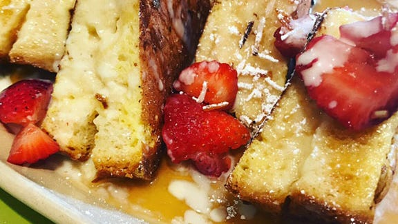Homemade stuffed french toast made with love from Snooze.