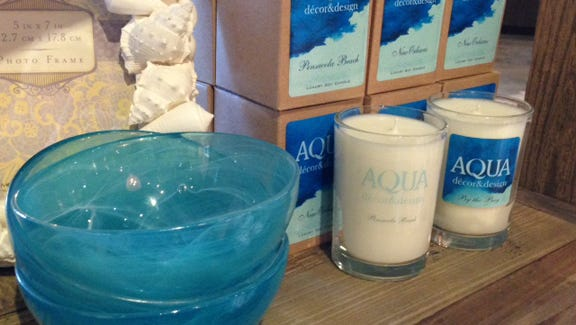 Aqua luxury soy candles in 10 fragrances, including Pensacola Beach.