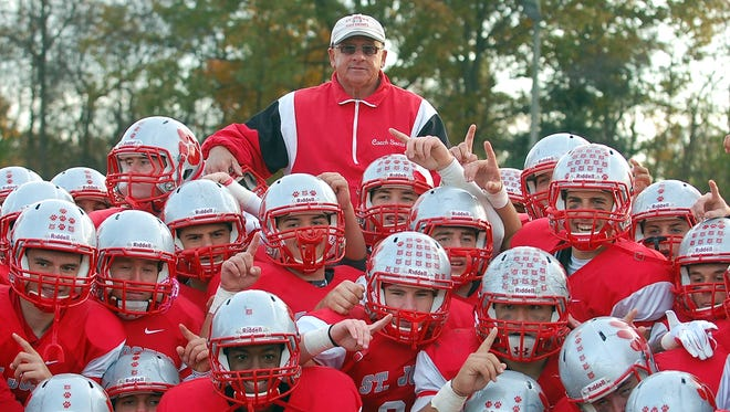 Paul Sacco of St. Joseph is lifted by his players after becoming the winningest football coach in South Jersey history Saturday. Sacco raised his career record to 286-56-5.