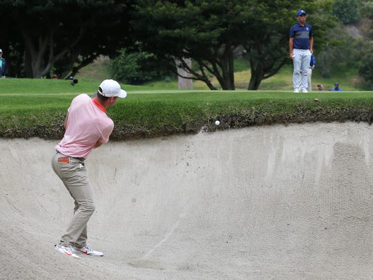 Doc Redman hits from a bunker on the 14th hole during the championship round of the USGA Amateur Golf Championship at the Riviera Country Club in the Pacific Palisades area of Los Angeles, Sunday, Aug. 20, 2017. (AP Photo/Reed Saxon)