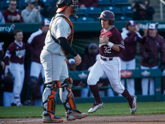 John Privitera, of Missouri State, scores as the Bears took on Oklahoma State in their 2018 home opener at Hammons Field on Wednesday, March 7, 2018.