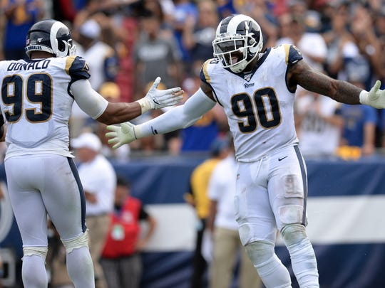 Los Angeles Rams defensive end Michael Brockers (90) celebrates with defensive tackle Aaron Donald (99) on a defensive play against the New Orleans Saints. Gary A. Vasquez-USA TODAY Sports
