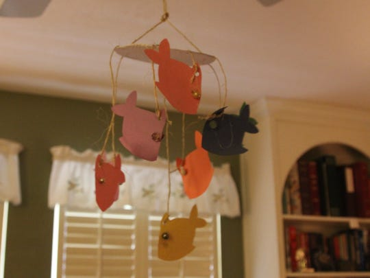 Fish hanging from the ceiling fan.