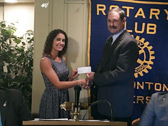 Hammonton Rotary Foundation Scholarship winner Gabrielle Sirolli accepts congratulations and a check from Jerry Daunoras, club treasurer.