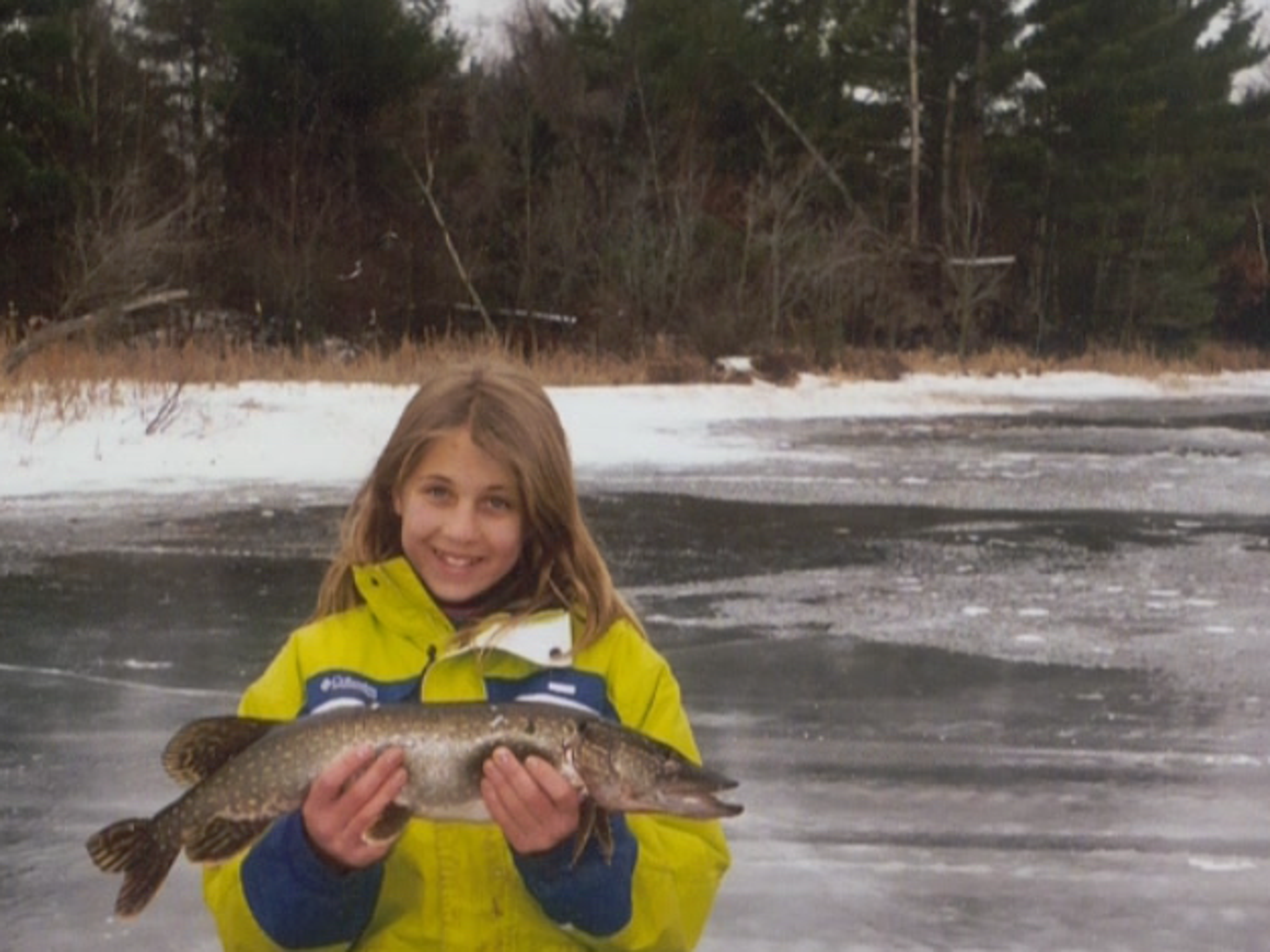 A young Gabrielle poses with her catch of the day.