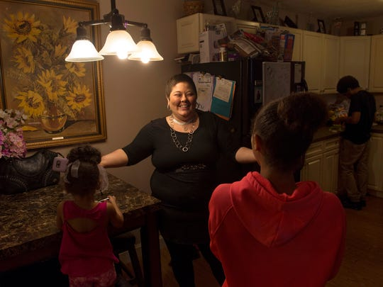 """Heather Ota, center, is surrounded with love from her children, from left, Kimiko, 3, Parielle, 12, and Brandon, 16. """"We've always been close,"""" the mom who is fighting cancer said. """"But this has brought us even closer together."""""""