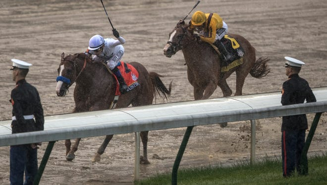Justify pulls away from Good Magic in the stretch run to the finish of the Kentucky Derby.  May 5, 2018