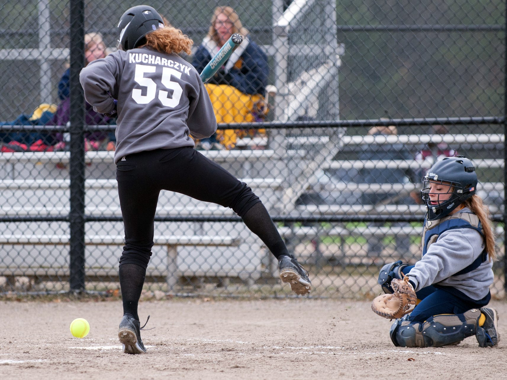 The ball bounces off Lakeview batter Kim Kucharczyk in the first game of the Gull Lake Softball Invitational on Saturday.