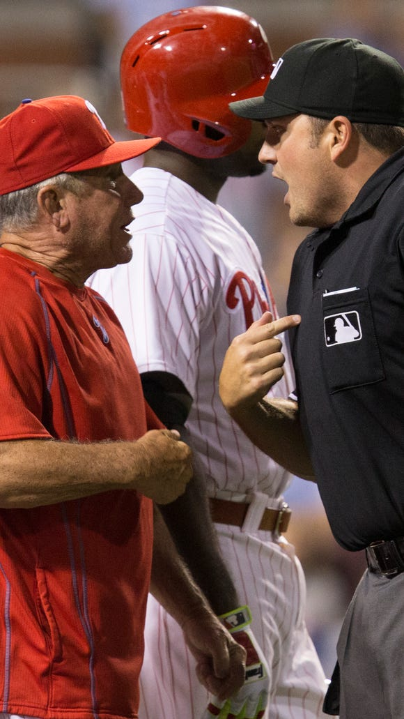Home plate umpire Dan Bellino ejects Phillies bench coach Larry Bowa after he disputed a quick pitch by Mets relief pitcher Hansel Robles in the seventh inning Tuesday.