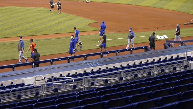 New York Mets players stretching before the start of a baseball game against the Miami Marlins at at Marlins Park in Miami on Thursday, Aug. 20, 2020. Mets game against the Marlins postponed due to reported COVID case on Mets.