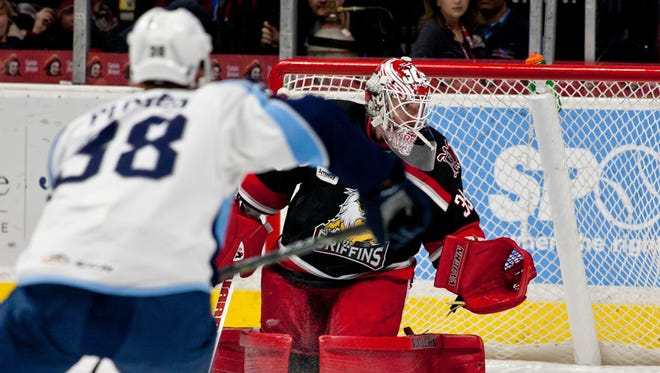 Jimmy Howard, playing goalie for the Grand Rapids Griffins, blocks a Milwaukee Admirals shot during an AHL hockey game Feb. 4, 2017 in Grand Rapids.