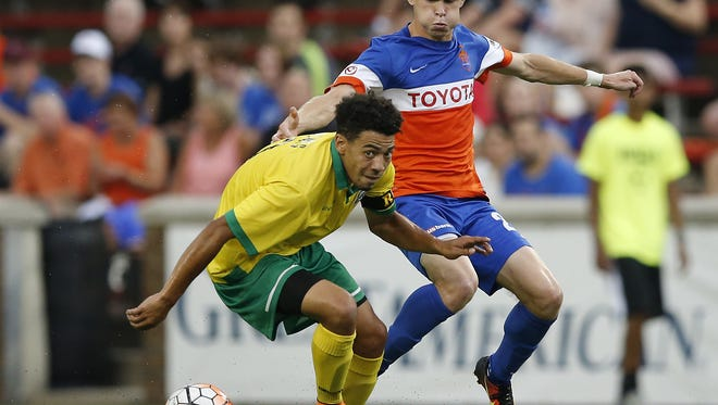 FC Cincinnati midfielder Jimmy McLaughlin (20) fights for possession in the first half during the USL soccer game between the Rochester Rhinos and FC Cincinnati, Wednesday, Aug. 24, 2016, at Nippert Stadium in Cincinnati.