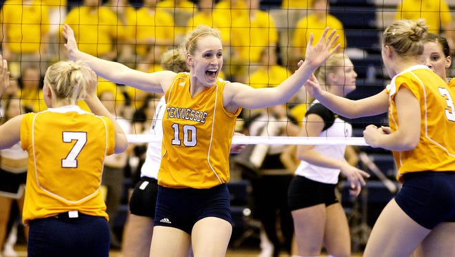 In this photo from 2005, Tennessee's Kristen Andre (10) celebrates a point in a game against Missouri during the NCAA women's volleyball regional championships. The university announced this week that its women's teams will be called Volunteers, just like the men's teams, except for the women's basketball team, which will remain the Lady Vols.