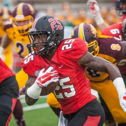 Ball State's Darian Green attempts to run past Central