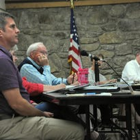The Montreat Board of Commissioners voted 3-2 to reimburse a group of residents that sued the town in order to prevent the construction of a new town hall.