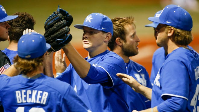 Kentucky Wildcats starting pitcher Zack Thompson high fives his teammates after being taken out of the game against the Louisville Cardinals at Cliff Hagan Stadium in Lexington, Kentucky on Tuesday, April 18, 2017. Michael Reaves/Special to The Courier Journal