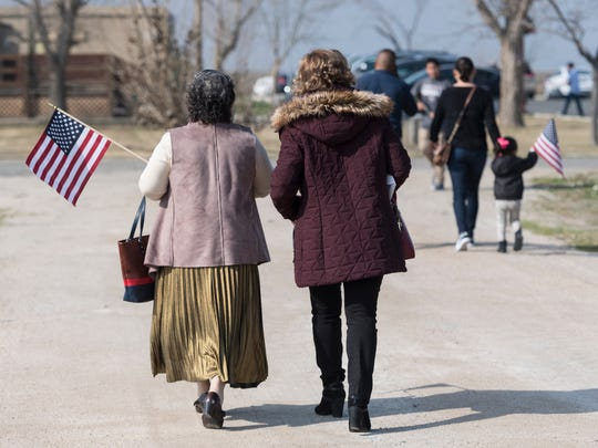 New citizen Berta Giron from Guatemala walks with Ana Giron after 32 immigrants from seven countries became U.S. citizens Friday, February 2, 2018 during the Naturalization Ceremony at Colonel Allensworth Historic Park.