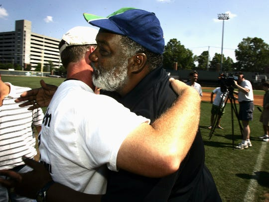Vanderbilt Baseball coach Tim Corbin left, gets a hug