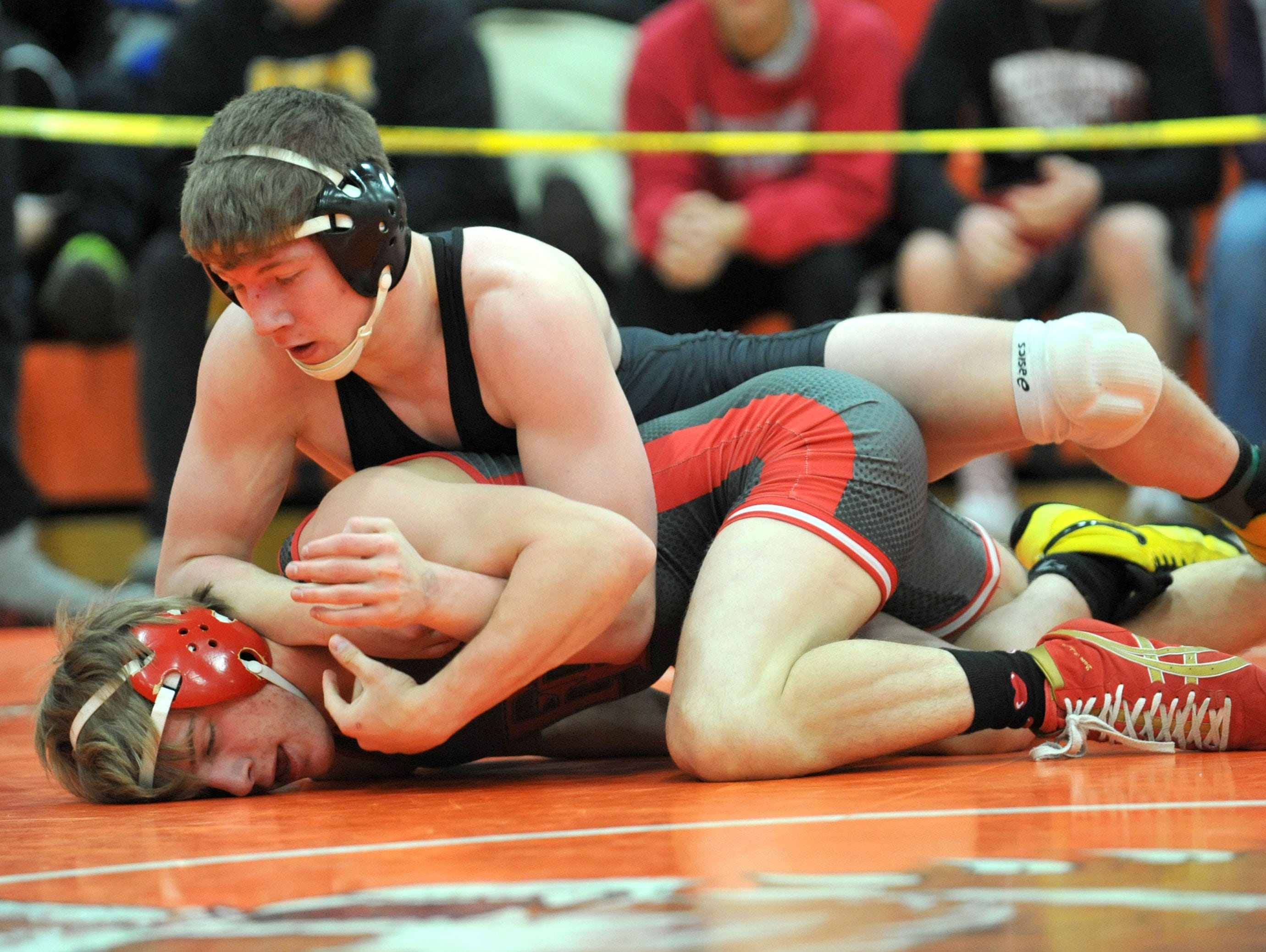 (top) Lexington's Brandon Leynaud wrestles Fredericktown's Carson Mills Saturday night during the 53rd J. C. Gorman Invitational. Leynaud placed first in the 132 lb weight class.