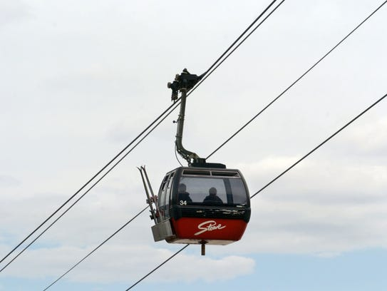Two skiers ride the gondola up Mt. Mansfield at Stowe