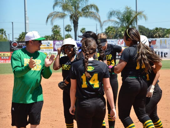 The Bishop softball team cheers after they won a recent