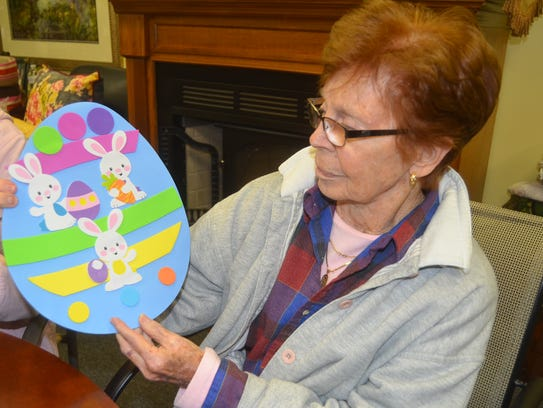 Martha Justice, who used to volunteer and now is a client at The Veranda in Gallatin, displays her Easter Egg decoration.