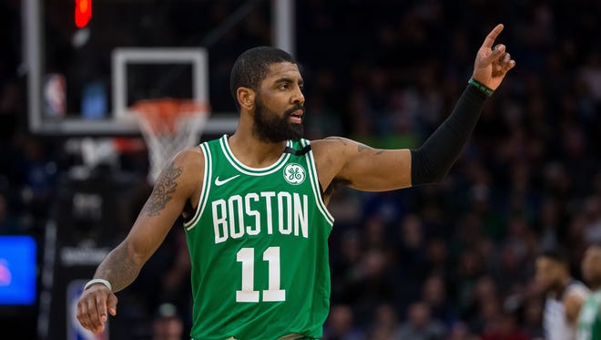 Boston Celtics guard Kyrie Irving (11) reacts in the first quarter against the Minnesota Timberwolves at Target Center.