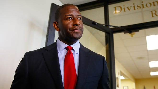 Tallahassee mayor Andrew Gillum completes his qualification paperwork to compete on the Democratic ticket for governor at the R.A. Gray Building on Monday.