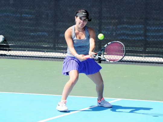 Wylie's Analeah Elias hits a backhand during the District