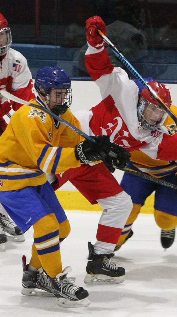 Mahopac's Brian O'Shea checks North Rockland's Chris