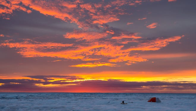 The Greenland ice sheet has been melting at a faster rate due to sunny summer days.