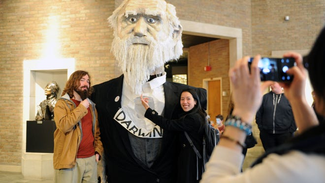 The Mcclung Museum celebrates Darwin Day Feb. 5. This phohto from the 2016 event shows University of Tennessee graduate students Orlando Schwery and Angela Chuang with a giant Darwin puppet.