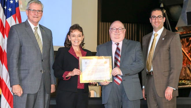 Dr. Leonard T Reinsfelder, commandant of the National Cryptologic School for the NSA, and Daniel R. Stein, Acting Branch Cybersecurity Education and Awareness Office of Cybersecurity for the Dept. of Homeland Security, present the CAE 2-Y certificate to Dr. Allanna Hamilton and Dr. Tom Pigg of JSCC.