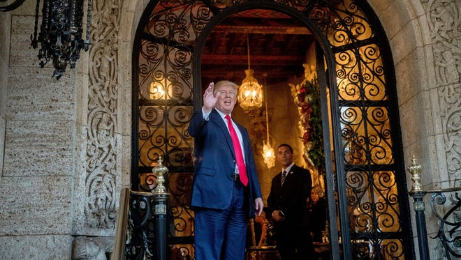 President-elect Donald Trump waves to members of the media after a meeting with admirals and generals from the Pentagon at Mar-a-Lago, in Palm Beach, Fla., Wednesday, Dec. 21, 2016. (AP Photo/Andrew Harnik)