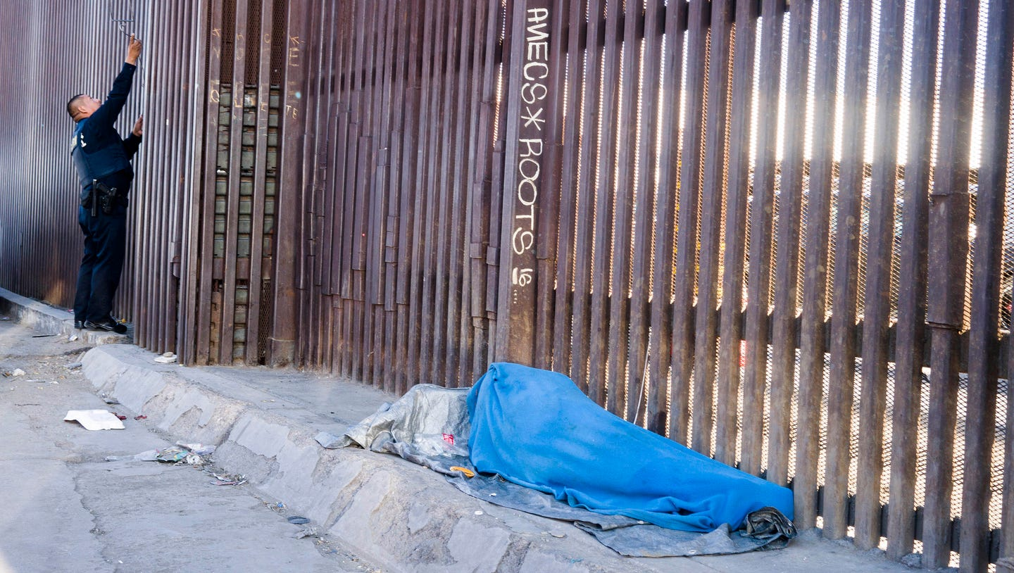 A human smuggler, and the wall that will make him rich