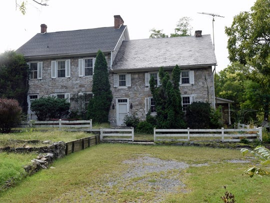 The Allison-Ebbert farmhouse is seen Friday, September