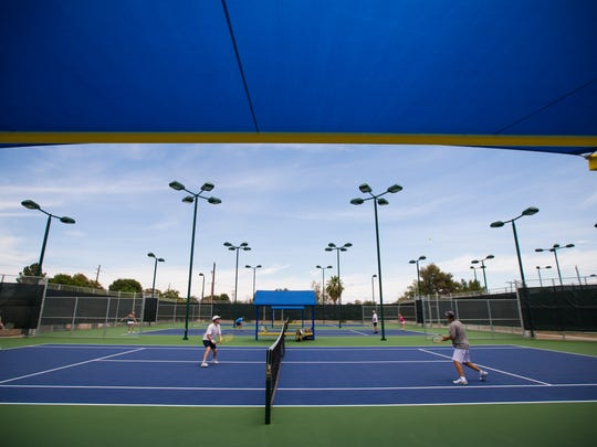 Players compete in USTA league play at the Phoenix Tennis Center on May 25, 2014. The city is completing the center's second phase of major renovations to restore it to championship-level status.