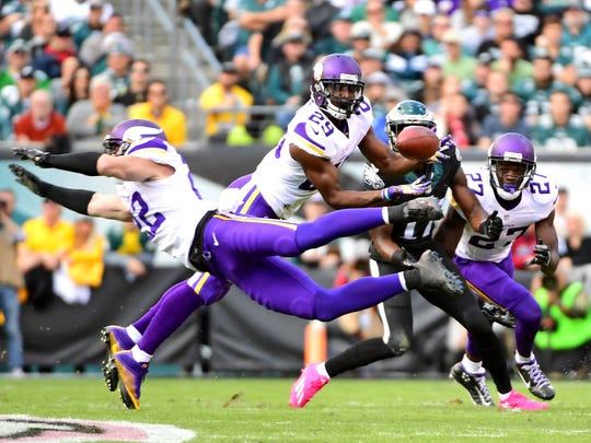 Oct 23, 2016; Minnesota Vikings cornerback Xavier Rhodes (29) intercepts a pass during the first quarter against the Philadelphia Eagles at Lincoln Financial Field.