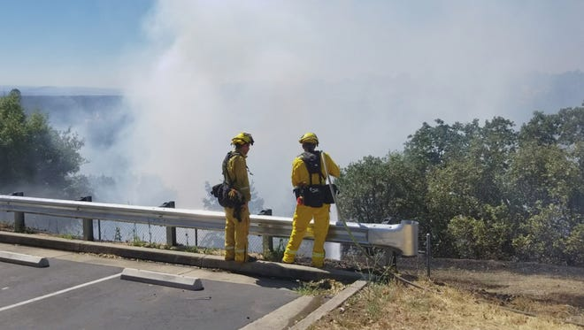 Redding firefighters were able to stop a vegetation fire before it reached the south parking lot at Mercy Medical Center in Redding on Thursday morning