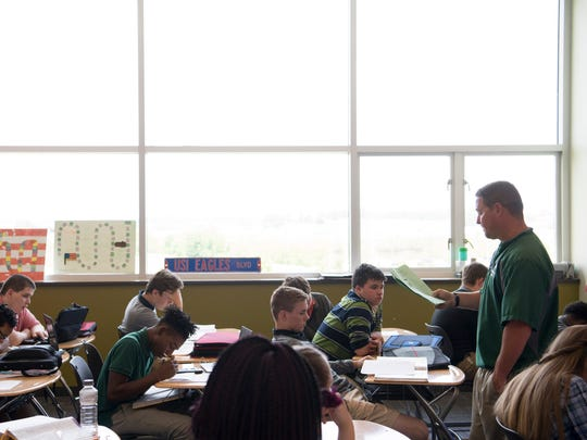 North High School teacher Jeremy Jones quizzes his