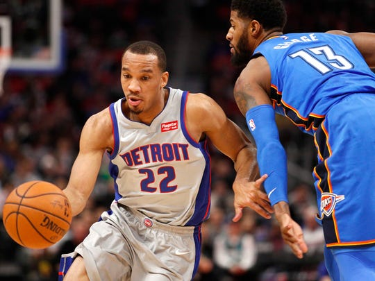 Pistons guard Avery Bradley dribbles by Thunder forward Paul George during the first quarter at Little Caesars Arena on Saturday, Jan. 27, 2017.