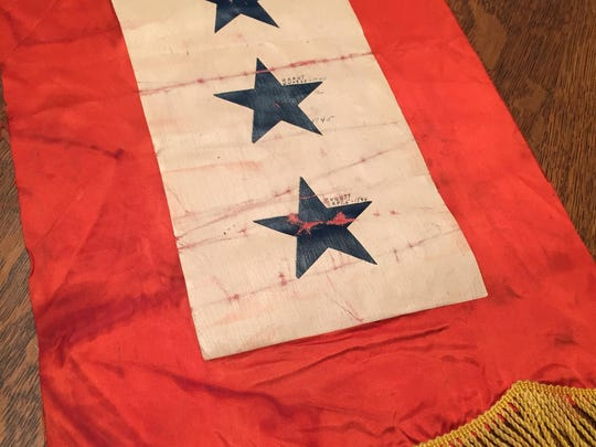 Mary Fisher bought this World War II service flag for $1 at a rummage sale two years ago at Salem Heights Elementary School.