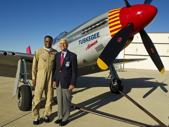 Brad Lang, left, with Colonel Charles McGee, a Tuskegee Airmen pilot, after landing a North American P-51 Mustang at Purdue University Airport in 2012.