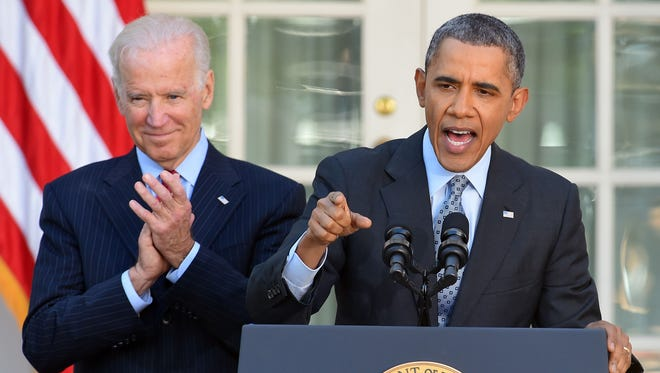 President Obama is accompanied by Vice President Biden as he delivers a statement on the Affordable Care Act at the Rose Garden of the White House on April 1, 2014.