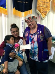 "Continuing its mission of serving the needs of the community and its project of ""Caring for the Sick and the Elderly."" Guam Sunshine Lions Club donated $200 on February 20,  to Christine Quinata, 50, to assist in off-island medical treatment expenses. Pictured from left: Christine Quinata, her granddaughter, and Lion Ewy Taitano, sponsor, Immediate Past President of the Guam Sunshine Lions Club, and Region 1, Zone 2 Chairperson of LCI District 204."